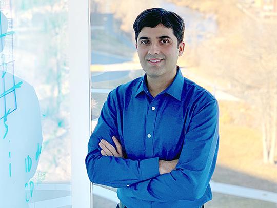 Abhinav Bhatele standing at a whiteboard